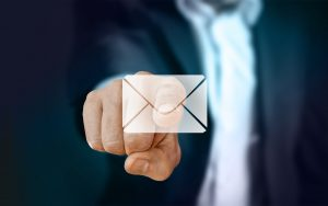 businessman pointing on envelope